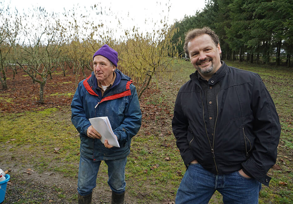 Pat Long and Dr. Charles Lefevre at Pat's successful orchard. Photo by David Barajas