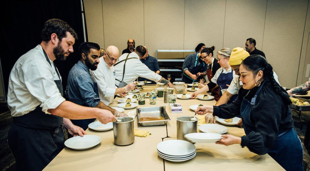 2020 Grand Truffle Dinner chefs and assistants working together to prepare an epic feast.  – Photo by Kathryn Elsesser