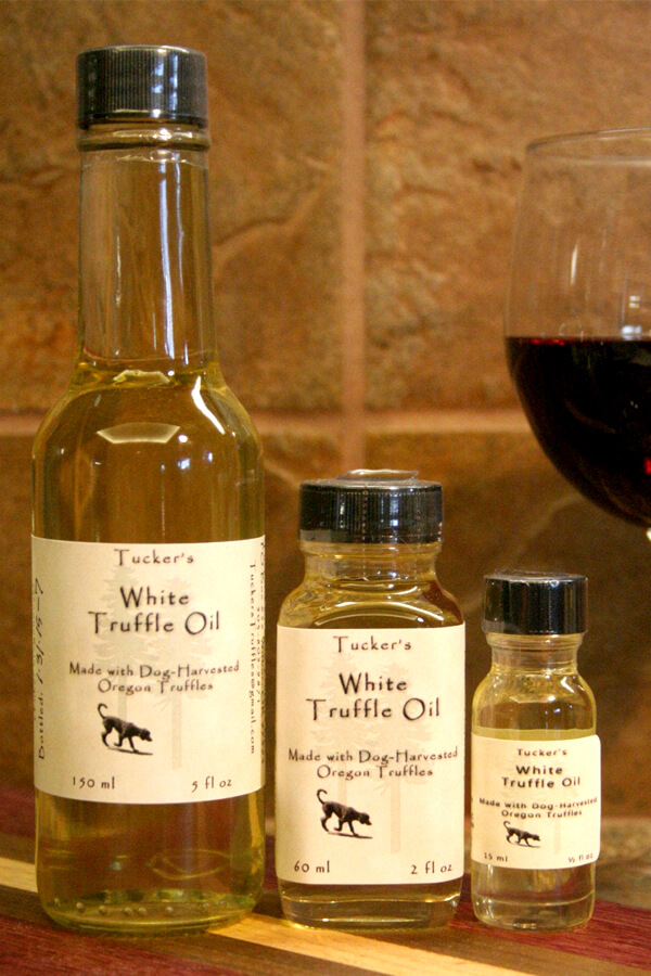 3 different sized bottles of Tucker's Oregon White Truffle Oil