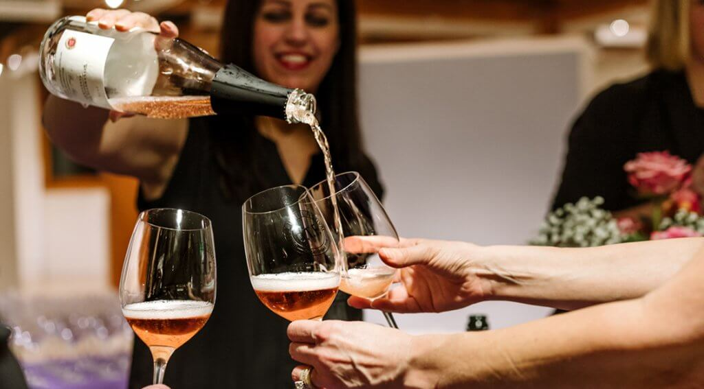 Weekend guests enjoy a Sparkling Brut Rose from Willamette Valley Vineyards at Treasures of Earth and Sea on Valentine's evening. – Photo by Reagon Kastner